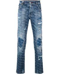 Philipp Plein Vaqueros pitillo con logo estampado - Azul