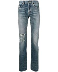 Saint Laurent - Ripped Stonewashed High Rise Jeans - Lyst