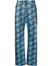Walter Van Beirendonck Pantalones anchos con motivo en zigzag - Azul