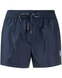 Dolce & Gabbana Short de bain à logo brodé - Bleu