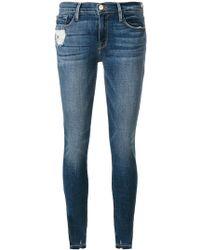FRAME - Jeans Aderenti Con Strappi Alle Caviglie - Lyst
