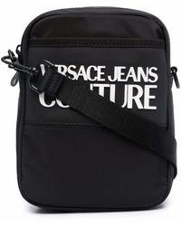 Versace Jeans Couture Debossed-logo Zipped Messenger Bag - Black