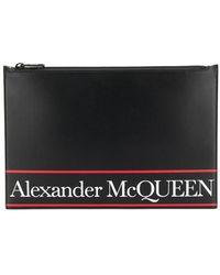 Alexander McQueen Bolso de mano plano con estampado de letras del logo - Negro