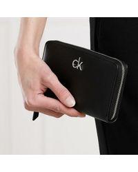 Calvin Klein Zip Around Wallet Large - Zwart