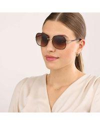 Prada 0pr 67xs 2au6s1 Woman Sunglasses Catwalk - Bruin