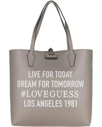 56f56bc82750 Guess - Bobbi Large Inside Out Shopper Pewter stone - Lyst