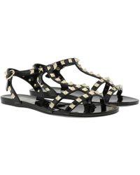 beca7f74ffa4 Valentino - Rockstud Flat Sandals Soft Pvc Black - Lyst