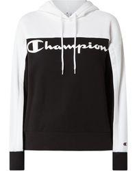 Champion - Hoodie mit Logo-Print - Lyst