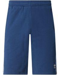 adidas Shorts aus Baumwolle mit Logo-Streifen - Blau