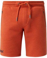 Superdry Sweatshorts mit Reißverschlusstaschen - Orange