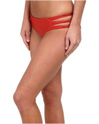 Mikoh Swimwear Velzyland Skinny String Triple Looped Bottom red - Lyst