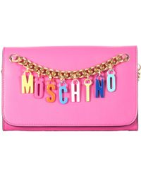 Moschino Pink Leather Pochette With Charms Logo pink - Lyst