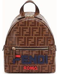 e8b39eba9e Fendi + Fila Appliquéd Leather Bag Charm And Shell Backpack in White ...