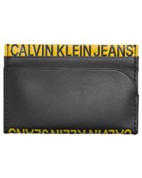 Calvin Klein Porte-cartes Noir Jaune