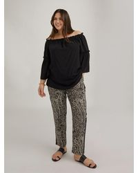 FIORELLA RUBINO Pantaloni stampati con bordi neri - Nero