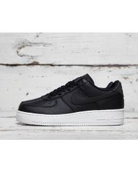 Shop Nike Air Force 1 Flyknit Low Black/Black Team Red Clear Jade