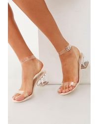 46ad6594609 Forever 21 Clear Ankle-wrap Lucite Heels in Metallic - Lyst
