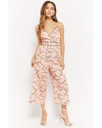 dc520ccfe35 Lyst - Forever 21 Surplice Floral Jumpsuit in Black