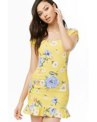 9a47513c29d Lyst - Forever 21 Floral Mini Wrap Dress in Blue