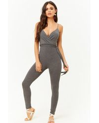 2c2371824d9 Forever 21 Surplice Woven Jumpsuit in Green - Lyst