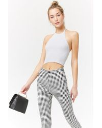 d69435fcd3 Forever 21 - Women s Cropped Ribbed Knit Halter Top - Lyst