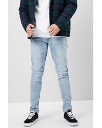 Forever 21 - Faded Wash Skinny Jeans - Lyst