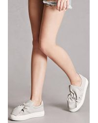 Forever 21 - J Slides Leather Bow Sneakers - Lyst