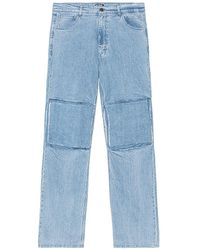 Raf Simons Relaxed Fit Denim Trousers With Cut Out Knee Patches - Blue