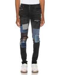 Amiri Skinny-fit Paneled Distressed Stretch-denim Jeans - Black