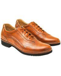 Pakerson Handgefertigte Schnürschuhe aus italienischem Leder in orange