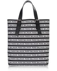 42e7d671405f Lyst - Saint Laurent Classic Toile Monogram Duffle 24 Bag In Black ...