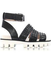 RED Valentino Black Leather Flat Sandals w/Studs - Schwarz
