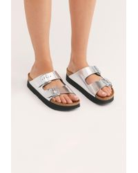 24a3206442e52 Lyst - Free People Arizona Metallic Birkenstock in Blue