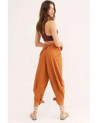 Free People Stunner Trousers By Fp Beach - Orange