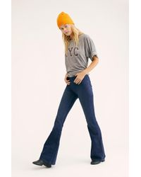 Free People Penny Pull-on Flare Jeans By We The Free - Blue