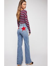 Free People Firecracker Flare Jeans By We The Free - Red