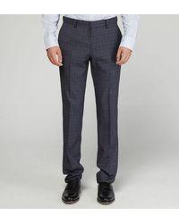 Comptoir GL Pantalon de costume Phil slim en laine à carreaux - Bleu