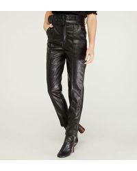 The Kooples Pantalon 7/8 slim enduit noir