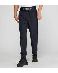 Calvin Klein Jogging imperméable ceinture siglée - Noir
