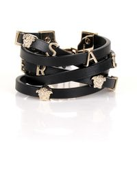 Versace - Logo Leather Strap Bracelet Black/light Gold - Lyst