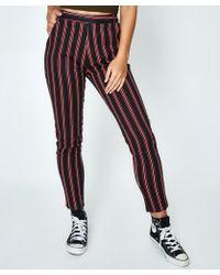 Neon Hart - Calypso Cigarette Pant Stripe Black/red - Lyst