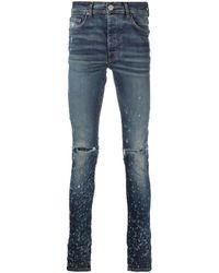 Amiri Jeans skinny con effetto vissuto Shotgun - Blu