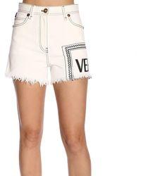 Versace - Logo Printed Cotton Denim Shorts - Lyst