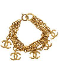Chanel Gold-tone Ridged Cc Bracelet - Metallic