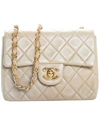 Chanel Beige Quilted Lambskin Leather Half Flap Bag - Natural