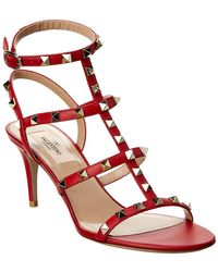 a5db3c804917 Lyst - Valentino Studded Leather And Pvc Sandals in Brown