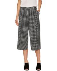 St. John - Simple Dot Print Stretch Culottes - Lyst