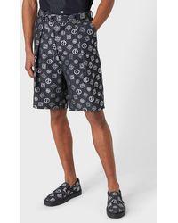 Giorgio Armani Bermuda Shorts In Denim-effect Fabric With An All-over Logo - Blue