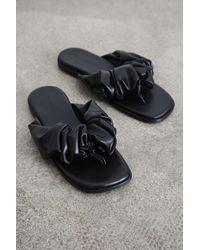 Glassworks Black Puffed Vegan Leather Sliders