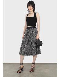 Glassworks Ivory And Black Leopard Velvet Pleated Skirt